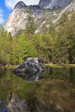 Mirror Lake Rock. Iconic boulder reflected in the clear, still waters of seasonal Mirror Lake below Half Dome in Yosemite National Park, California Stock Images