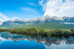 Mirror Lakes. Are a famous natural landmark omn the Milford Road in the Fiordland National Park. Snowy mountains are reflecting in a calm water. New Zealand Royalty Free Stock Photos