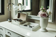 Mirror,lamp,jewelry and makeup box on a table Royalty Free Stock Photos