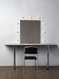 Mirror with lamps for makeup, black chair Royalty Free Stock Image