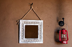 Mirror lantern on mud wall Stock Photography