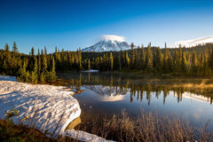 Mirror like reflection and mount Rainier Stock Photo
