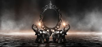 Mirror magical, fortune telling and fulfillment of desires. Golden elephant on a wooden table. Dark room, light effect. Beautiful statuette of an elephant on royalty free stock photos