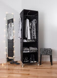 Mirror and mobile wardrobe with clothing Stock Photos
