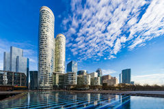 Mirror of modern buildings. On the blue color fountain in the Business district, La Defense, West Paris, France Stock Image