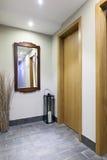 Mirror in modern hotel corridor Stock Image