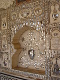 Mirror mosaic. Painting of ceilings of harem. India. Jaipur. Amber fort Royalty Free Stock Photo