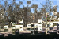 Mirror mosaic reflects everything around in the center of Paris city stock photography