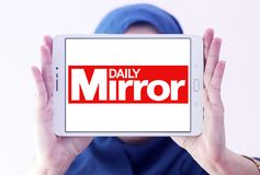 Daily Mirror newspaper logo. Logo of Daily Mirror newspaper on samsung tablet holded by arab muslim woman. The Daily Mirror is a British national daily tabloid Stock Image