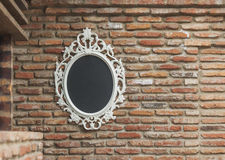 The mirror on the old brick wall Royalty Free Stock Images