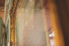 Mirror in old gilded frame. Royalty Free Stock Photos