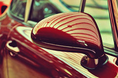 Mirror of the original cherry-old car. Retro style. Sophisticati Stock Images