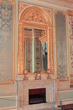 The mirror over the fireplace in the bedchamber. Royalty Free Stock Photo