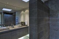Mirror Over Washbasin In Bathroom Stock Image