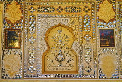 Mirror Palace Of Amber Fort. The Mirror Palace or Sheesh Mahal at Amber Fort. Beautified wall paintings with multi mirrored glass inlaid panels stock photography