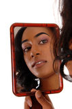 Mirror picture of african american girl. Stock Photo