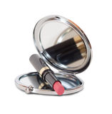 Mirror and pink lipstick Stock Images