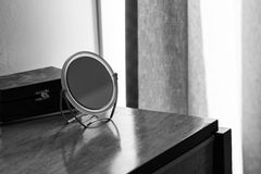Mirror on Polished Wood Dresser in Bedroom Royalty Free Stock Images