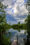 Mirror pond. Beautiful mirror pond and white clouds on the sky Stock Images