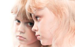 Mirror portrait of a little blond girl Stock Images