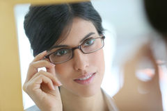 Mirror portrait of woman wearing eyeglasses Stock Photography