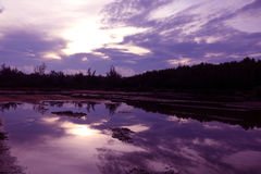 Mirror of purple sky in the morning reflection to the water. Stock Images