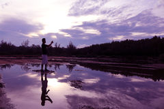 Mirror of purple sky reflection to the water with shadow of photographer. Stock Images
