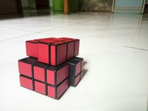 Mirror Puzzle Cube. Hard play easy red smart intelegence kid toy puzzle cubing Royalty Free Stock Photography