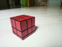 Mirror Puzzle Cube. Hard play easy red smart intelegence kid toy puzzle cubing Stock Images