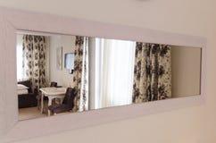 A mirror reflecting room interiors stock photos