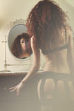 Mirror reflection of a beautiful woman in lingerie Royalty Free Stock Photos