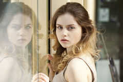 Mirror reflection. Beautiful young blonde and Mirror reflection Royalty Free Stock Photos