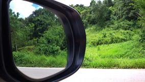 Mirror reflection. Car mirror reflection on the road Royalty Free Stock Image