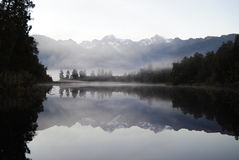 Mirror reflection at dawn on Lake Matheson Stock Photography