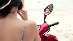 A mirror reflection of a girl with helmet on bike stock video