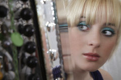 Mirror Reflection Of Girl Looking Away Royalty Free Stock Image