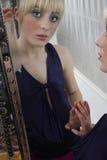 Mirror Reflection Of Girl Wearing Eye Makeup Stock Photos