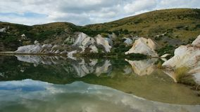 Mirror reflection in the lake at an old gold mine at Saint Bathans. Central Otago, New Zealand. royalty free stock photography