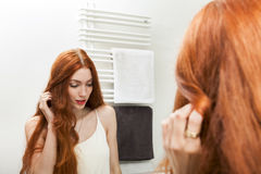 Mirror Reflection of a Long Hair Young Woman Royalty Free Stock Images