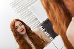 Mirror Reflection of a Long Hair Young Woman Royalty Free Stock Photo