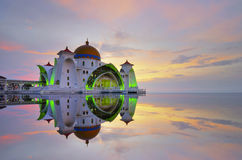 Mirror reflection of majestic floating mosque at malacca straits Royalty Free Stock Photos