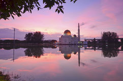 Mirror reflection of majestic mosque during sunset Royalty Free Stock Photos