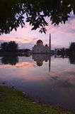 Mirror reflection of majestic mosque during sunset Stock Images