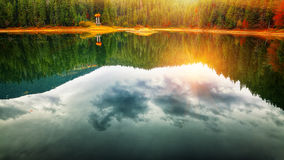 Mirror reflection in picturesque lake Royalty Free Stock Photo