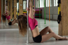 Mirror reflection of pole dancer Royalty Free Stock Photography