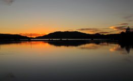 Mirror Reflections, Dusk at Big Bear Lake, California. The still lake at dusk acts as a mirror by the Stanfield Cutoff in Big Bear Lake, located in the San Royalty Free Stock Photography