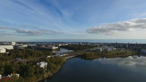 A mirror-smooth water Sea Bay and the city park in Helsinki. Aereal filming stock video footage