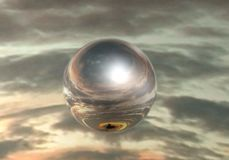 Mirror sphere. Mirrored sphere on sky background Royalty Free Stock Image