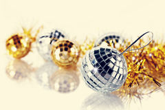 Mirror spheres and New Year's tinsel. Stock Photos