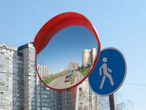 The mirror is spherical and road sign Royalty Free Stock Photo